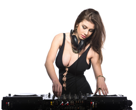Young sexy dj woman against white background. photo