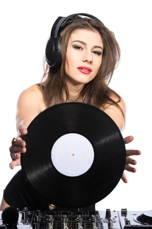 Woman dj portrait with vinyl record and headphones, isolated on white background.