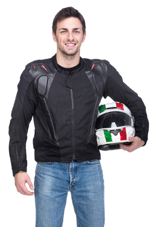 biker man: Portrait of a young motorcyclist is holding a helmet posing isolated on white background.