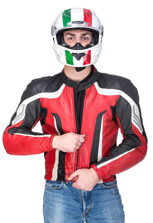 Portrait of a motorcyclist biker in red equipment and helmet isolated on white background.