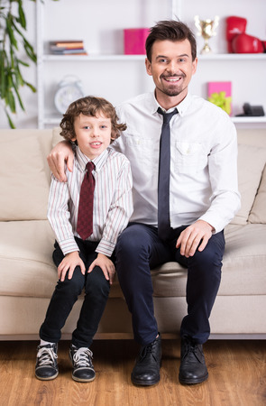 Portrait of a young father and his son in a shirt and tie. photo