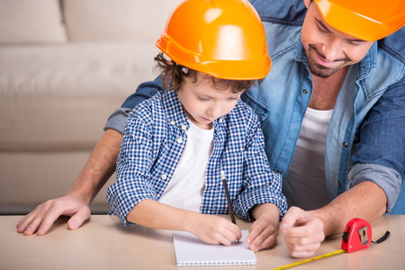 dad and son: Young father teaches his little son tinkering. Stock Photo