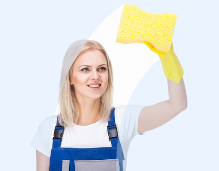 Young female cleaner is cleaning on white background.