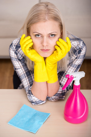 Portrait of woman is doing some cleaning work in the house. photo