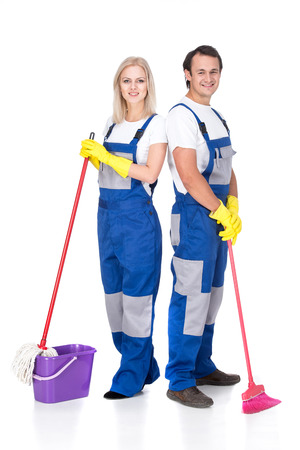 Young smiling cleaner man and woman. Housework. Isolated on white background.