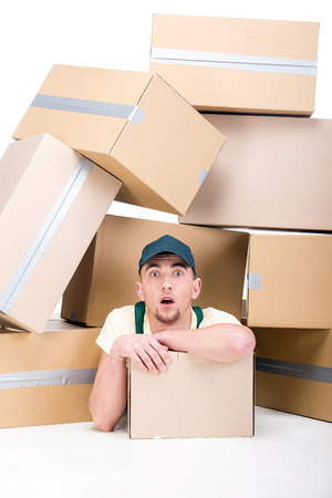 Young man with cardboard boxes on the floor.  photo
