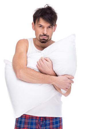 striped pajamas: Hombre agotado con la almohadilla en el fondo blanco.