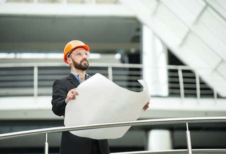 industrial safety: Young male architect in the modern office. Stock Photo