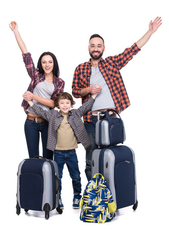 happy family: Happy family with luggage are ready to travel. Isolated on white background. Stock Photo