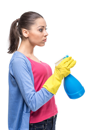 Young woman with detergent, isolated on white background.
