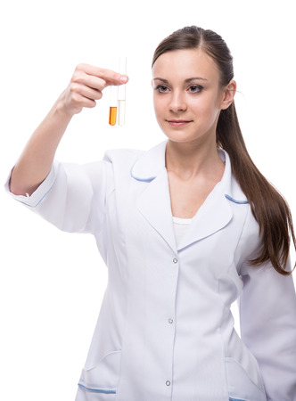 Young woman doctor is holding flasks, isolated on white background. photo