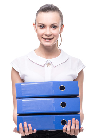 Young smiling woman is holding folders isolated over a white background. photo