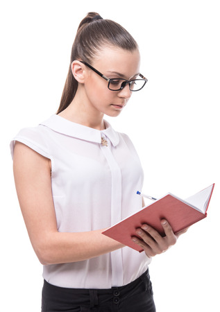 Young smiling woman is holding notebook isolated over a white background. photo