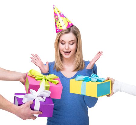 accepts: Happy young woman accepts gifts on her birthday. White background.