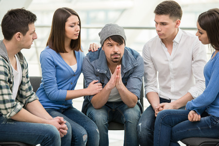 trust people: Circle of trust. Group of people are sitting in circle and supporting each other.