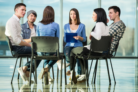 group discussions: Circle of trust. Group of people are sitting in circle and supporting each other.