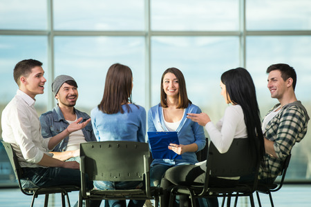 psychotherapy: Circle of trust. Group of people are sitting in circle and supporting each other.
