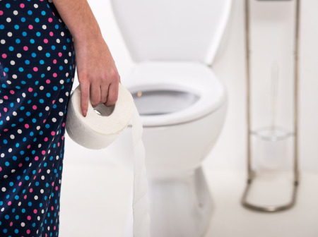 Close-up of woman on toilet in morning. Imagens - 35691142