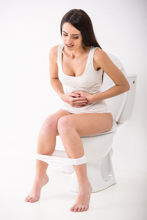 toilet roll: Close-up of woman on toilet in morning.
