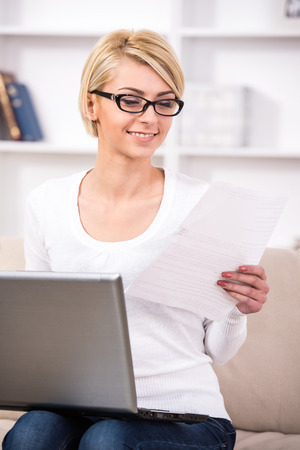 Young business woman is working with laptop. photo