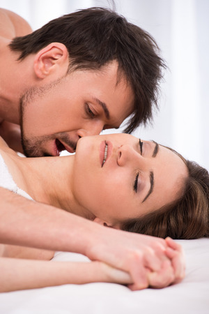 Young love couple in bed, romantic scene in bedroom. photo