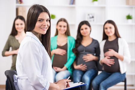 Pregnant women are listening to doctor at antenatal class at the hospital