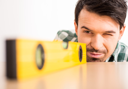 Repair home concept. Close-up of young man with ruler level. Stok Fotoğraf