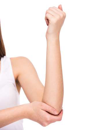 acute: Acute pain in a woman elbow. Female is holding hand to spot of elbow pain indicating location of the pain. Isolation on a white background.