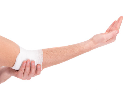 elbow bandage support: Close-up hand of man, injured painful elbow with white bandage.