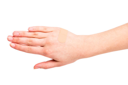 adhesive bandage: Adhesive Bandage. Close-up hand of young woman with a adhesive bandage.