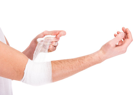 Close-up hand of man, injured painful elbow with white bandage.