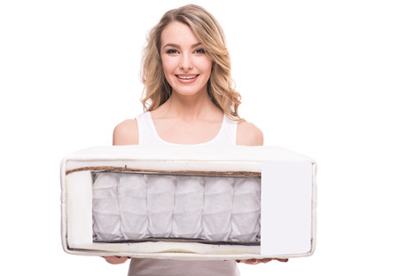 sleep well: Young woman with nice, quality mattress that supported you to sleep well all night. Stock Photo