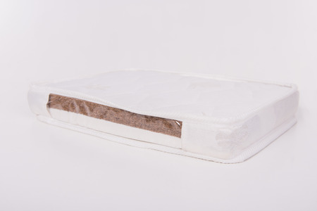 sleep well: Mattress made of coconut fiber, that supported you to sleep well all night isolated on white background.