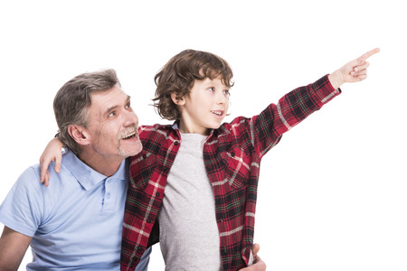 ��beautiful boy�: Beautiful boy with his grandpa, is pointing somewhere by hand. White background.
