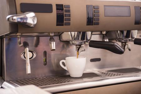 espresso machine: Close-up of an espresso machine making a cup of coffee.