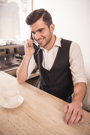 baristas: Baristas is taking orders over the phone. Stock Photo