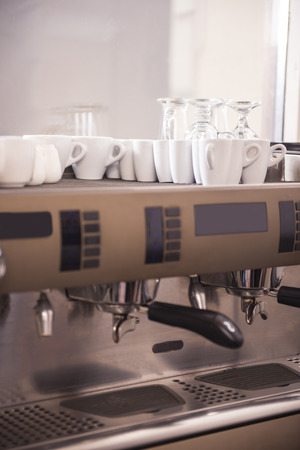 capacino: Close-up of an espresso machine with cups and glasses. Stock Photo