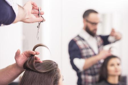 hairdresser: Close-up hairdresser cutting hair a woman in hairdresser salon. Stock Photo
