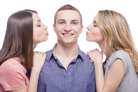 two face: Love triangle. Two young women kissing to the man. isolated on white background.