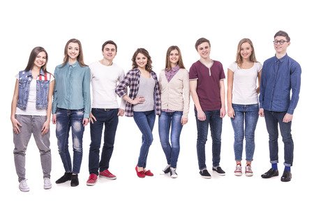 full lenght: Full lenght. Happy  smiling young group standing and looking at camera. isolated on white background.