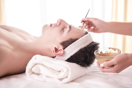 beauty parlour: Spa therapy for young asian woman receiving facial mask at beauty salon.