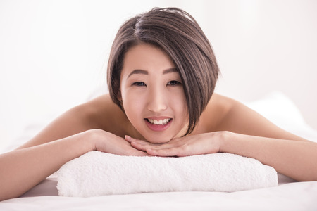 Close-up of a Young Female Getting Spa Treatment. Spa therapy. photo