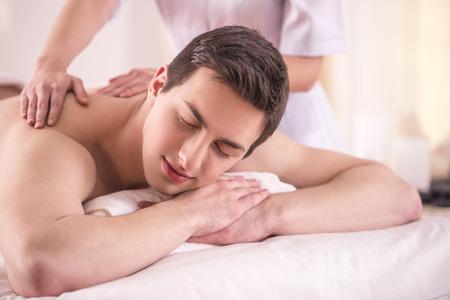 handsom: Handsom young male having massage in beauty salon.