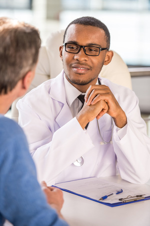 pharmacist: Medical concept. Doctor talking to his male patient. Stock Photo
