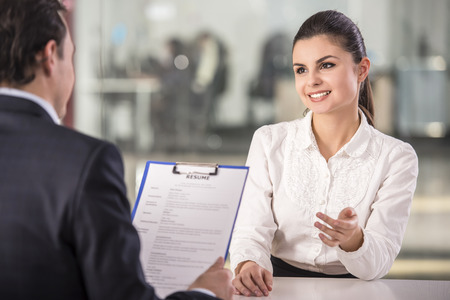 business interview: Businessman interviewing female candidate for job in office. Stock Photo