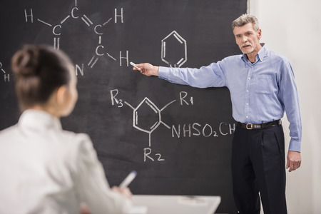 lecturing: Professor of chemistry leading lecture in University.
