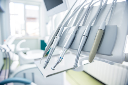 medical office: Different dental instruments and tools in a dentists office
