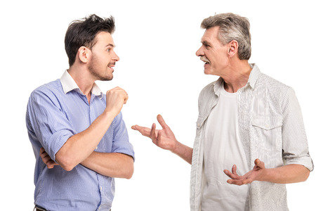 Senior father with adult son talking, isolated white . Stockfoto