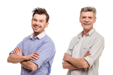 Adult son with senior father smiling and holding crossed hands, isolated white . Stock Photo