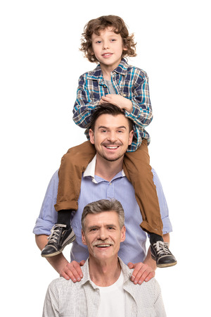 Generation portrait. Grandfather, father and son, isolated a white background.